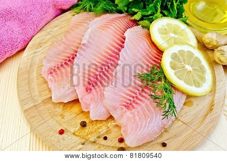 Tilapia with oil and lemon on light board