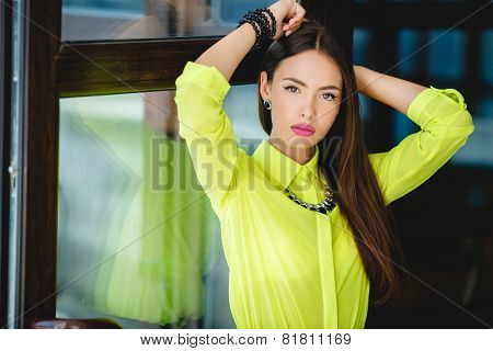 Portrait of a beautiful young Oriental woman in the office.