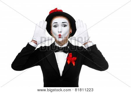Portrait of the surprised mime with their hands up