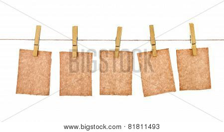 Kraft Paper Hang From Clothespins On Isolated White Background