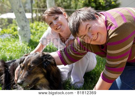 Two Women And A Half Breed Dog