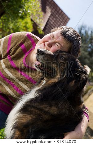 Disabled Woman Cuddles A Dog