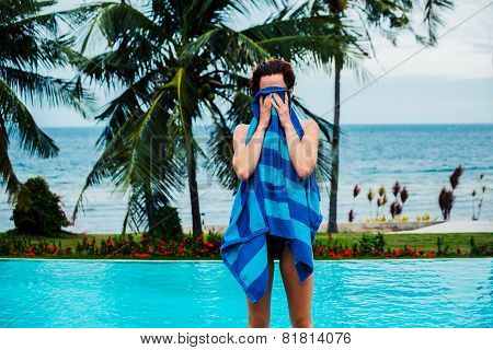 Woman Drying Herself With Towel By Swimming Pool