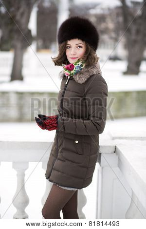 Sweet Young Woman In A Short Warm Coat
