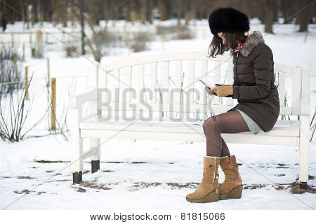 Young Woman Reading Old Letters