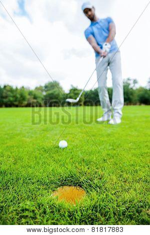Golfer Putting.