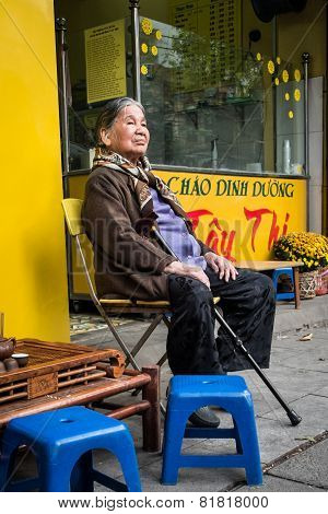 Elderly Vietnamese Woman Sitting In The Street