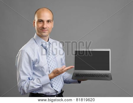 Businessperson Showing A Laptop With Blank Screen