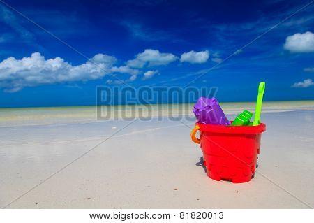 kids toys on sand beach