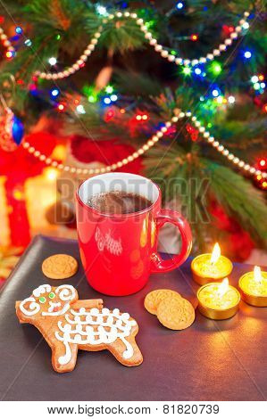Sheep Shape Gingerbread With Cup Of Coffee On Christmas Background.