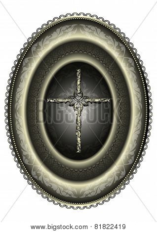 Oval silver medallion with cross framed patterned border