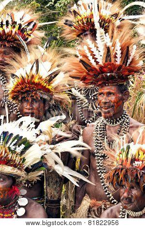 Village tribe warriors in bird feathers head gear
