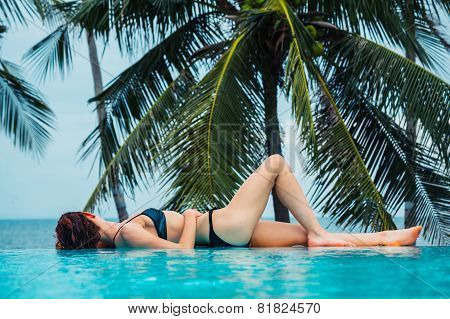 Sexy Young Woman Relaxing By Swimming Pool