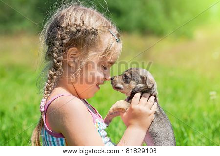 Child with a puppy