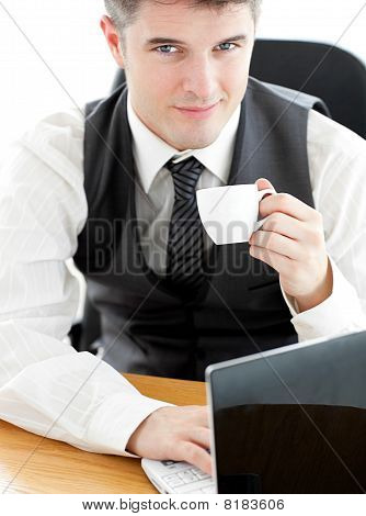 Jolly Young Businessman Looking At The Camera Holding A Coffee