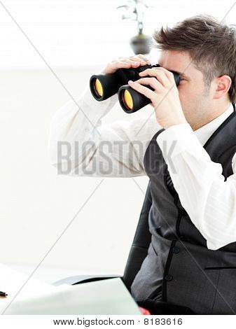 Close-up Of A Young Businessman Looking Through Binoculars Isolated