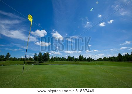 Golf course with yellow Flag