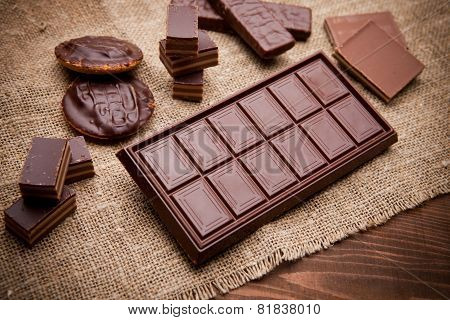 Chocolate Pieces On Wooden Table