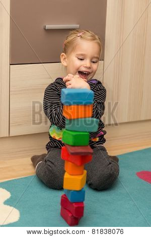 Little Girl Is To Be Glad About A Tower Of Bricks