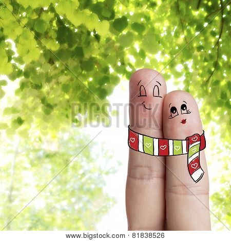 Finger art. Lovers is embracing and wearing a scarf. Stock Image