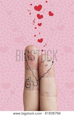Finger art of a Happy couple. Lovers is embracing and listening music. Stock Image