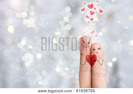 Finger art. Lovers is embracing and holding red heart. Stock Image