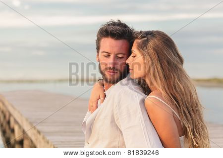 Woman Embracing Her Man From Behind At Seaside