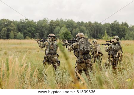 Group Of Soldiers Conducting An Offensive Against The Enemy
