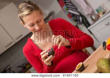 Pregnant Woman Eating A Fresh Passion Fruit