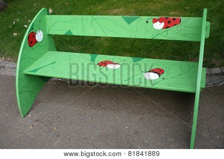 Bench with ladybirds in park in Pilsen