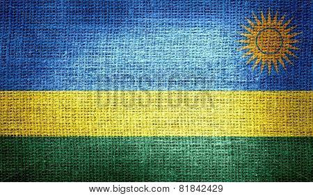 Rwanda flag on burlap fabric