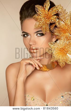 Beautiful Attractive Girl With Golden Flowers. Beauty Model Woman Face. Perfect Skin. Professional M