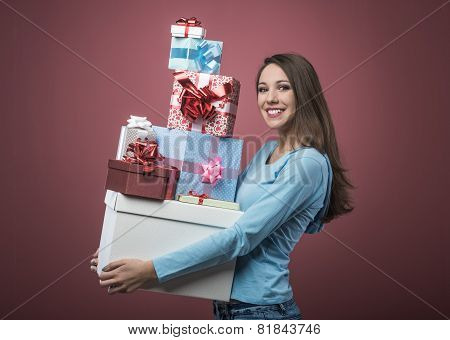 woman holding many gift boxes