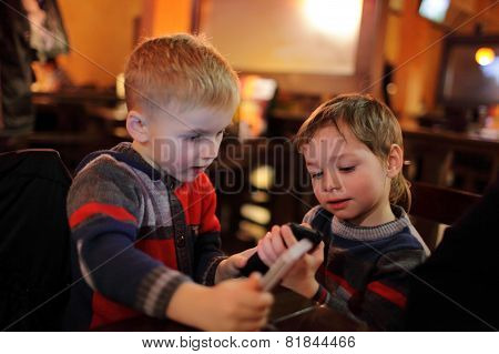 Two Boys With Smartphones
