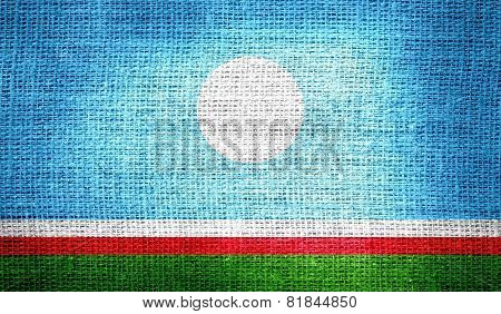 Sakha Republic flag on burlap fabric