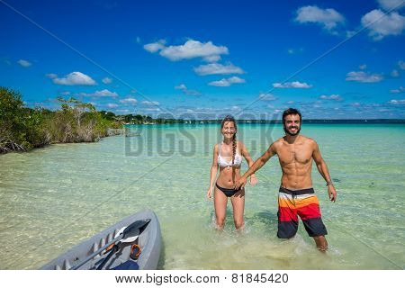 Beautiful Couple In Love Kayaking At Tranquil Bacalar Lake. Riviera Maya, Mexico. Tropical Travel.