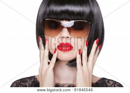 Red Lips Makeup And Manicured Polish Nails. Fashion Brunette Woman Wearing In Sunglasses Isolated On