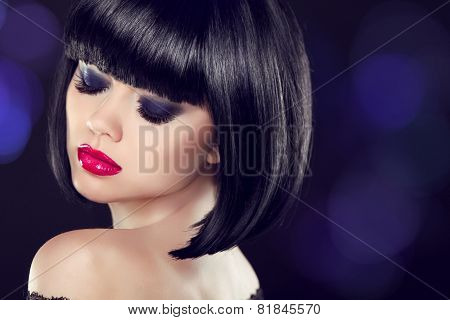 Makeup. Bob Short Haitstyle. Sexy Girl Model With Naked Shoulder Posing Over Dark Background. Blue E