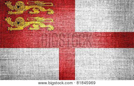 Sark flag on burlap fabric