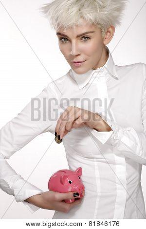 Business Woman Put A Coin On A Pink Piggybank