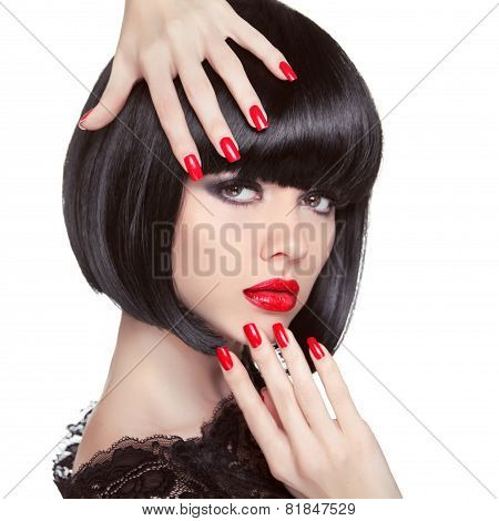 Beauty Fashion Brunette Model Portrait. Manicured Nails. Red Lips. Professional Makeup. Bob Hairstyl