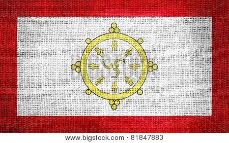 Flag of the monarchy of Sikkim from 1967 to 1975 on burlap fabric