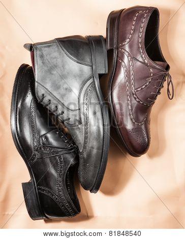 Set of trendy man footwear on a craft paper