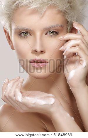 Beauty Model Applying Cosmetic Treatment  On Her Skin
