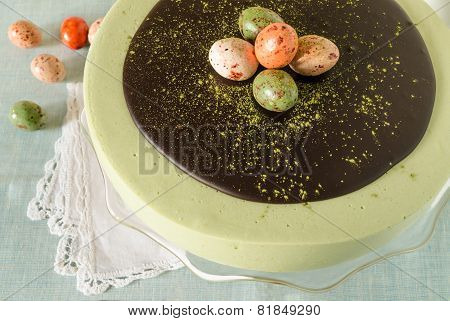 Easter cake with tea match decorated chocolate ganache and sweet-stuff eggs