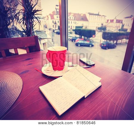 Vintage Instagram Like Toned Coffee Cup And Diary In Coffee Shop.