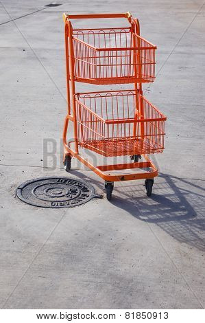 Orange trolley in a parking lot