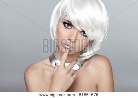 Beautiful Blond Young Woman With Polish Finger. Makeup. Manicured Nails. Studio Photo. Girl With Whi