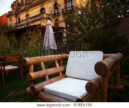 Comfortable wooden chair in a garden