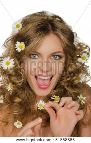 Beautiful Woman With Daisies In Hair Takes Petals